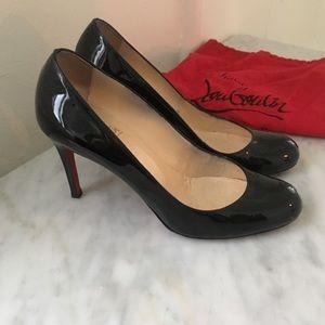 Christian Louboutin black leather pumps heels